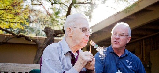 Hospice of the Valley volunteer blows bubbles with a person with dementia.